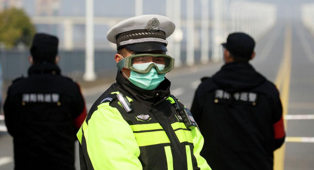 Кытай: коронавирус жуктуруп алганын жашыргандар өлүм жазасына тартылат